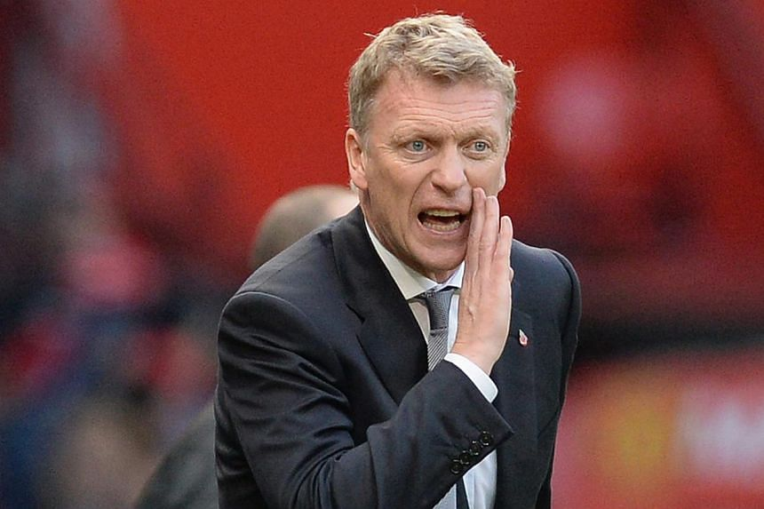 Manchester United's manager David Moyes gestures during their English Premier League soccer match against Stoke City at Old Trafford Stadium in Manchester, northern England, on Oct 26, 2013. Moyes on Wednesday, Jan 15, 2014, accepted a Football