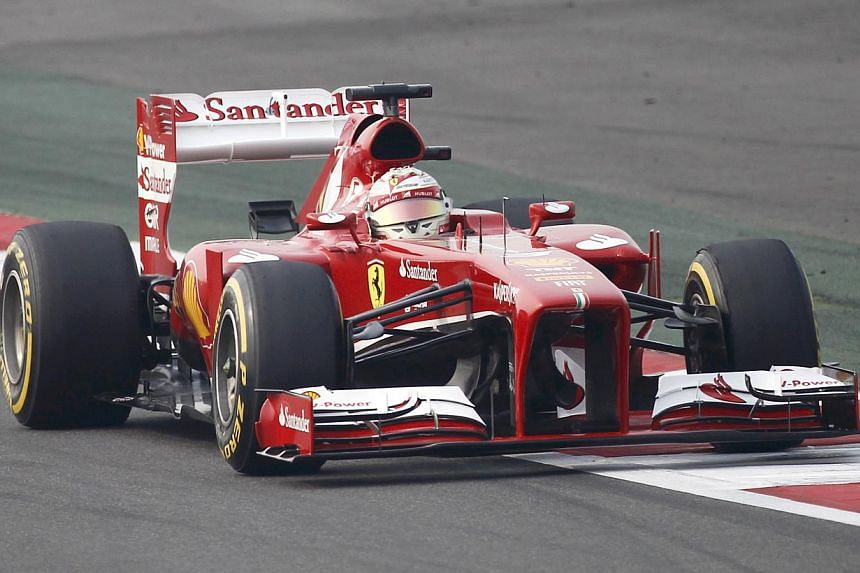 Ferrari Formula One driver Fernando Alonso of Spain drives during the qualifying session of the Indian F1 Grand Prix at the Buddh International Circuit in Greater Noida, on the outskirts of New Delhi, on Oct 26, 2013. Ferrari fans worldwide have been