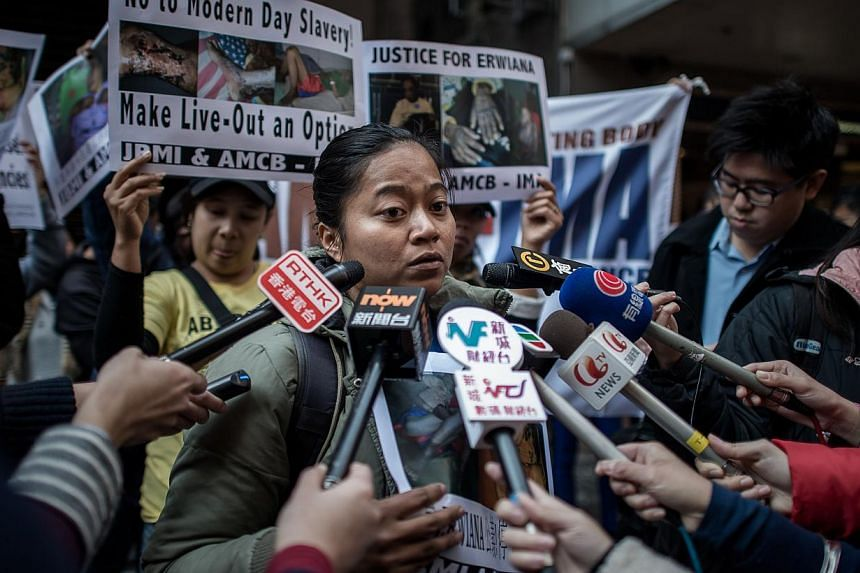 A protester answers questions from the media as maids and rights activists protest over allegations of an Indonesian maid being abused in Hong Kong, on Jan 16, 2014. -- PHOTO: AFP
