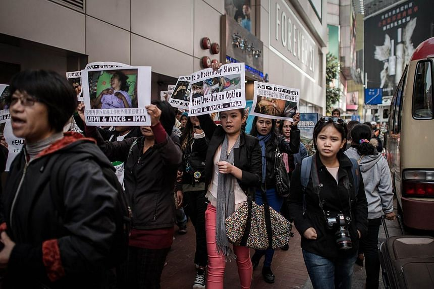 Maids and rights activists protest over allegations of an Indonesian maid being abused in Hong Kong, on Jan 16, 2014. -- PHOTO: AFP