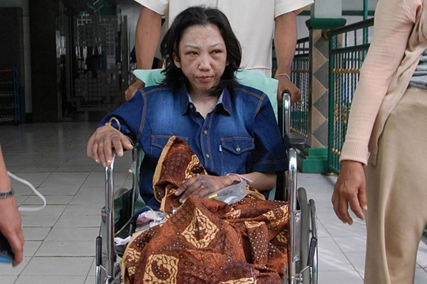 Indonesian Erwiana Sulistyaningsih sits in a wheelchair at a hospital in Sragen, on Jan 15, 2013. -- PHOTO: AFP
