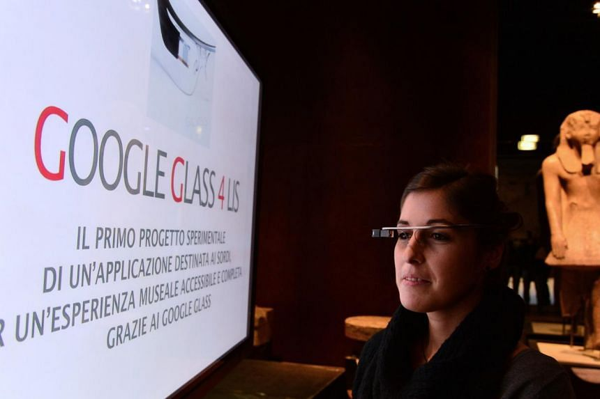 A woman tests Google Glass at the Egyptian Museum in Turin, on Nov 11, 2013. A woman ticketed for driving while wearing Google Glass, a tiny computer mounted on an eyeglass frame, is scheduled to appear in a Southern California traffic court on