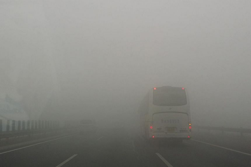 Severe smog likely caused a major chain accident on a Beijing highway on Wednesday morning that involved at least 30 vehicles. --PHOTO:SPH