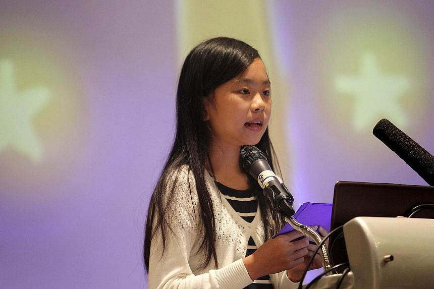 Megan also shared about her project to raise funds for the Animal Concerns Research and Education Society (Acres) by selling notebooks with animal-themed covers designed by herself. -- ST PHOTO: ONG WEE JIN