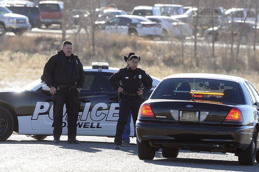 Law enforcement personnel set up a perimeter following an early morning shooting at Berrendo Middle School in Roswell, New Mexico on Jan 14, 2014. A 12-year-old accused of opening fire on Tuesday in a New Mexico middle school - wounding a teacher and