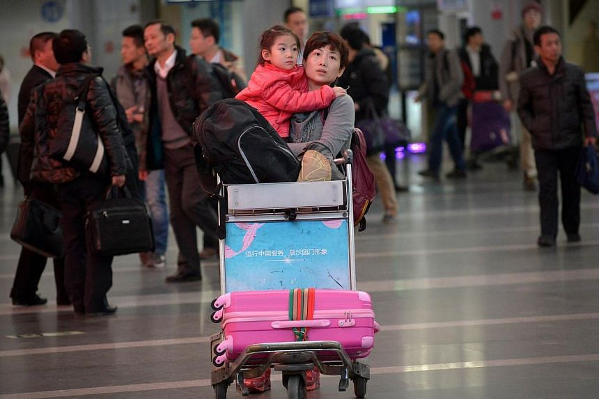 A family walks in Beijing's international airport, on Jan 9, 2014. A top Chinese official's claim that the country's citizens are discriminated against in visa arrangements worldwide prompted widespread online derision Thursday, Jan 16, 2014, with po