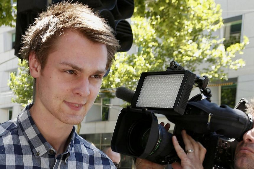 """Daniel Dobson, a 22-year-old Briton arrested during an Australian Open 2014 tennis match at Melbourne Park on Tuesday, leaves Melbourne Magistrates' Court Jan 16, 2014. Dobson, who was arrested at tennis' Australian Open on Tuesday for """"conduct that"""