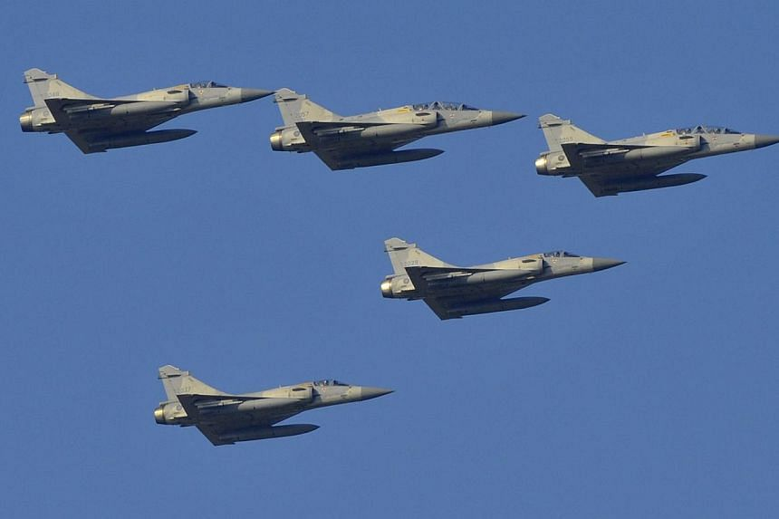 Indigenous Defence Fighter jets (IDF) fly during a combat skills demonstration at a military base in Tainan, southern Taiwan, on Jan 16, 2014.-- PHOTO: AFP