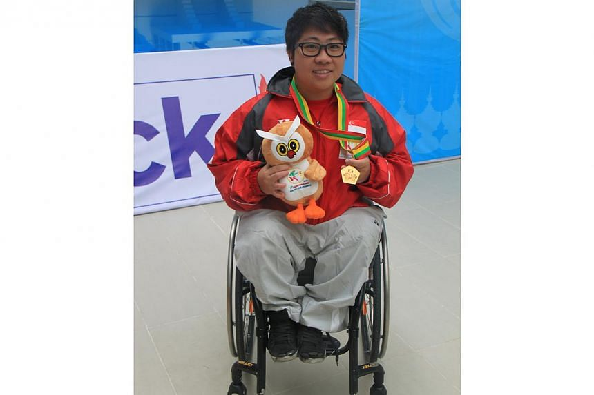 Swimmer Theresa Goh notched her second gold in as many days at the Asean Para Games on Thursday, Jan 16, 2014, with an imperious showing in the 200m freestyle (S5) race in Naypyidaw, Myanmar. -- PHOTO: SINGAPORE DISABILITY SPORTS COUNCIL
