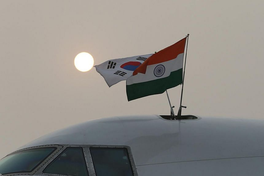 The national flags of South Korea and India fly from the plane carrying South Korean President Park Geun-hye as it arrived at Air Force Station Palam in New Delhi on January 15, 2014. Ms Geun-hye is in India for a four-day state visit. --PHOTO: AFP