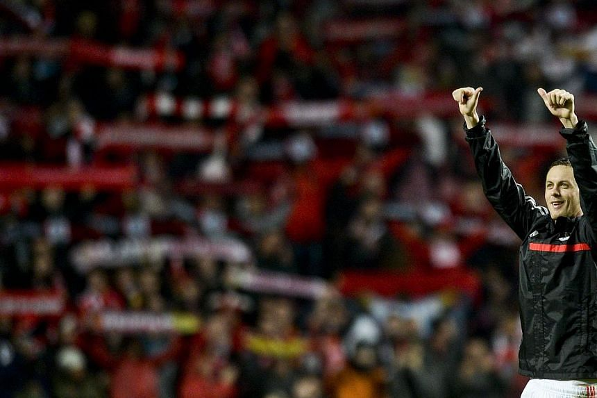 Midfielder Nemanja Matic gestures to the Benfica fans at the end of the Portuguese league football match SL Benfica vs FC Porto at Luz stadium on Jan 12, 2014.Chelsea re-signed Matic on a five-and-a-half-year contract from Portuguese giants Ben
