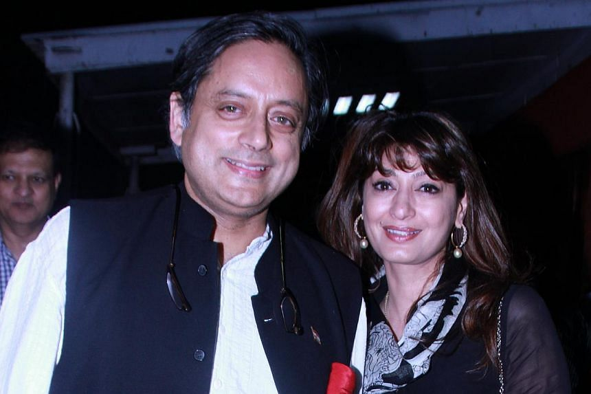 Mr Shashi Tharoor and wife Sunanda Pushkar during a special screening of Bollywood movie Lootera at the Film Division Auditorium, on July 3, 2013, in New Delhi, India.The furious wife of Mr Tharoor, the Indian government's top-tweeting minister