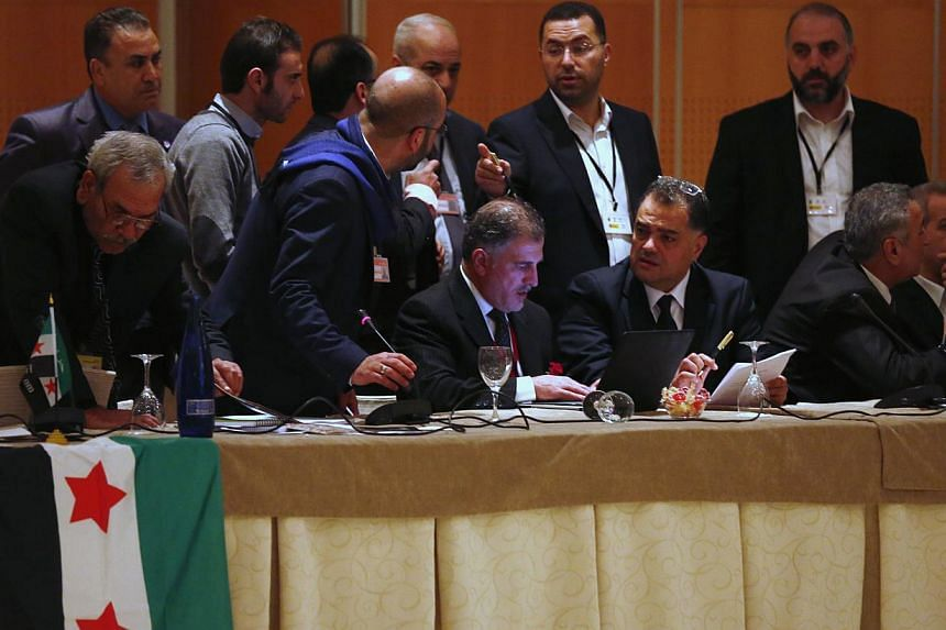 Members of Syrian opposition groups attend a consultative meeting in Cordoba, southern Spain on Jan 10, 2014.Rivalry between Qatar and Saudi Arabia has fuelled wrangling within the Syrian opposition that threatens to prevent a united rebel dele