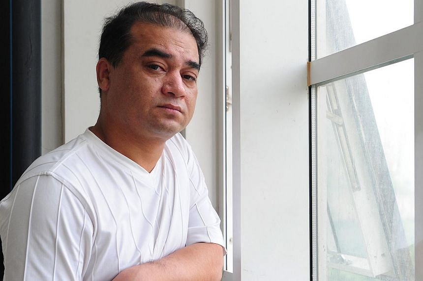 A file picture of University professor, blogger, and member of the Muslim Uighur minority, Ilham Tohti. Police in China have reportedly detained, Tohti, 45, an outspoken critic of government policy towards the mostly Muslim minority.--PHOTO: AFP&nbsp