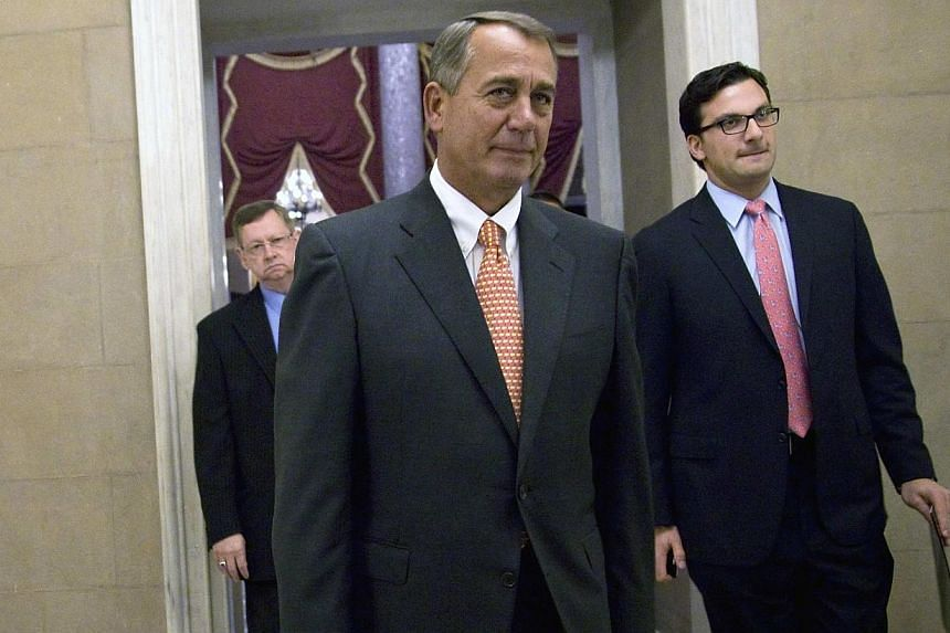 United States (US) House Speaker John Boehner, a Republican from Ohio, returns to his office after a vote on the House floor to approve a spending bill, at the US Capitol in Washington on Jan 15, 2014. The US House of Representatives overwhelmingly a