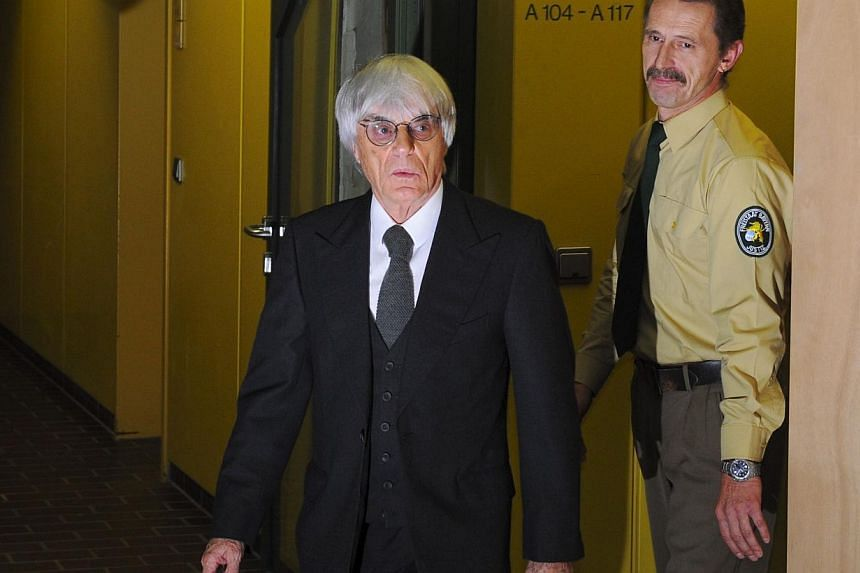 This picture taken on November 10, 2011 shows Formula One boss Bernie Ecclestone leaving the court in Munich, southern Germany, where a session of the trial against a former head of risk management at Bavarian bank BayernLB was held. A German court c