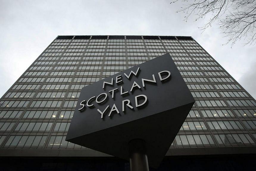 A sign is seen outside New Scotland Yard in central London, on Jan 10, 2014. British police arrested two women on Thursday on suspicion of terror offences, including one who was about to catch a flight to Istanbul, Scotland Yard said.-- FILE PH
