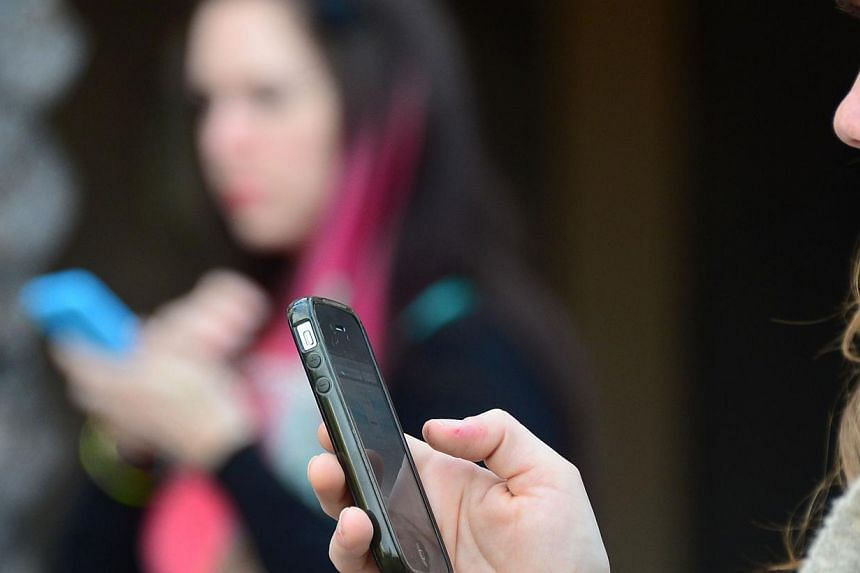 Women use their cellphones on Jan 7, 2014 in Los Angeles, California.The US National Security Agency has collected almost 200 million mobile phone text messages a day from around the world, a report said Wednesday, in the latest revelatio