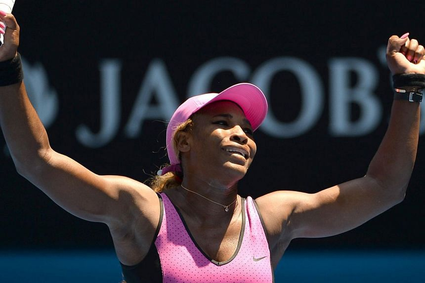 Serena Williams of the United States celebrates after victory in her women's singles match against Slovakia's Daniela Hantuchova on Day Five of the 2014 Australian Open tennis tournament in Melbourne on Jan 17, 2014. Williams set a new record of 61 A