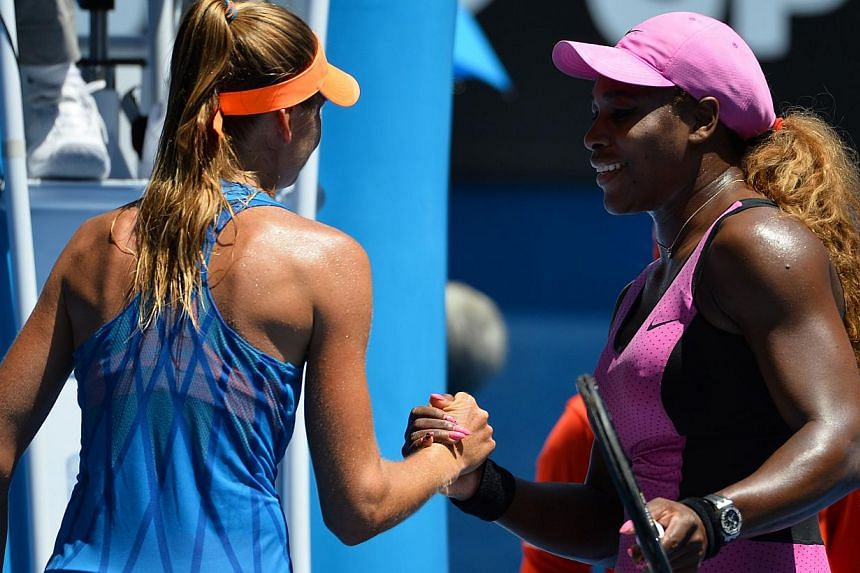 Serena Williams of the United States shakes hands after victory in her women's singles match against Slovakia's Daniela Hantuchova on Day Five of the 2014 Australian Open tennis tournament in Melbourne on Jan 17, 2014. Williams set a new record of 61
