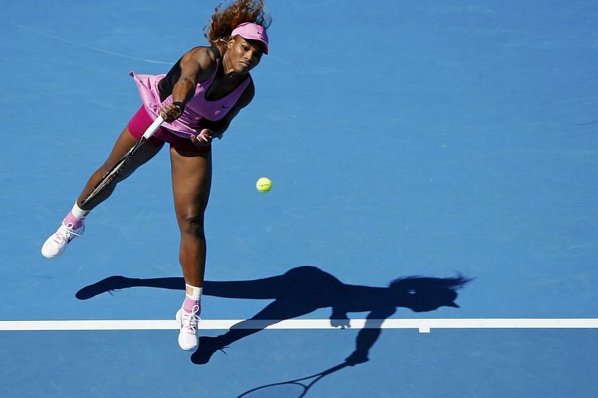 Serena Williams of the United Statesserves to Daniela Hantuchova of Slovakia during their women's singles match at the Australian Open 2014 tennis tournament in Melbourne on Jan 17, 2014. Williams set a new record of 61 Australian Open wins on