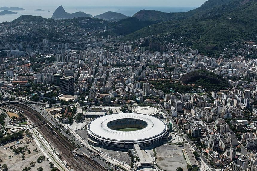 "Aerial view of the Mario Filho (Maracana) stadium in Rio de Janeiro, Brazil, on Dec 3, 2013. Government-backed Brazilian consumer groups on Thursday struck a deal with Rio hoteliers to ban ""abusive"" pricing and prevent fans being ripped off duri"