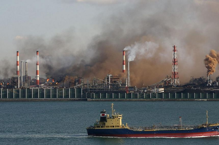 Smoke rises from the site of a fire at the Nagoya ironworks of Nippon Steel & Sumitomo Metal Corp. in Tokai, Aichi prefecture on January 17, 2014. There were no immediate reports of injuries or casualties. --PHOTO: AFP