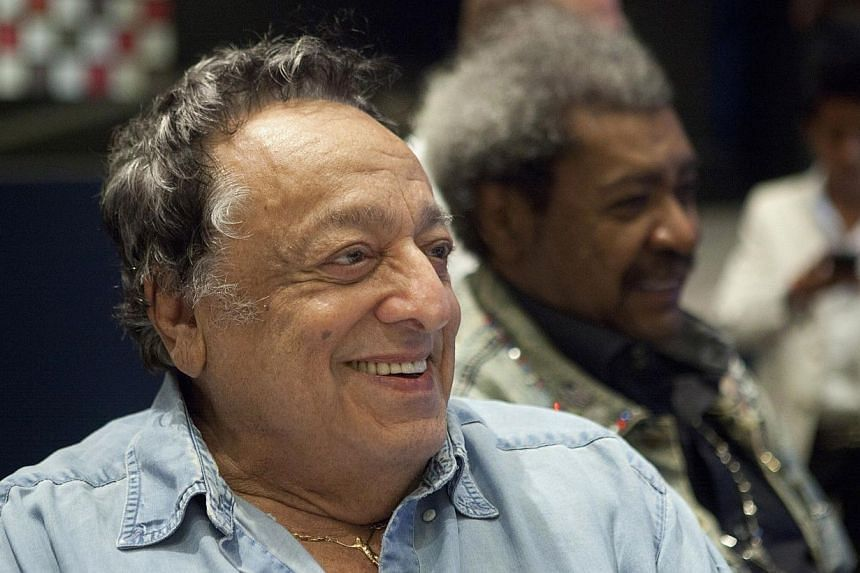 World Boxing Council (WBC) President Jose Sulaiman reacts, next to boxing promoter Don King (R), at the 50th Convention of the World Boxing Council in Cancun, on Dec 4, 2012. Jose Sulaiman, who ran the World Boxing Council (WBC) for 38 years, died on