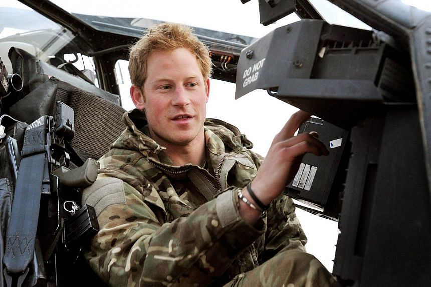 Britain's Prince Harry is to quit flying army Apache helicopters and take up a desk job organising commemorative military events, Kensington Palace said on Friday. -- FILE PHOTO: AFP