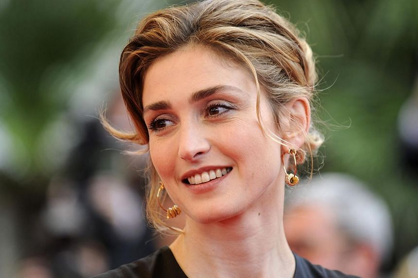 Ms Julie Gayet, 41, is seeking 50,000 euros (S$86,500) in damages and 4,000 euros in legal costs from the magazine over a report she claims breached France's privacy legislation. -- PHOTO: REUTERS