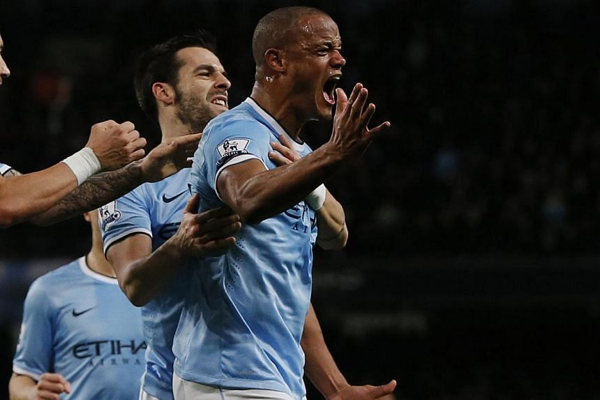 Manchester City's Vincent Kompany (right) celebrates with teammates after scoring a goal against Liverpool during their English Premier League soccer match at the Etihad stadium in Manchester, northern England on Dec 26, 2013. It is a matter of time