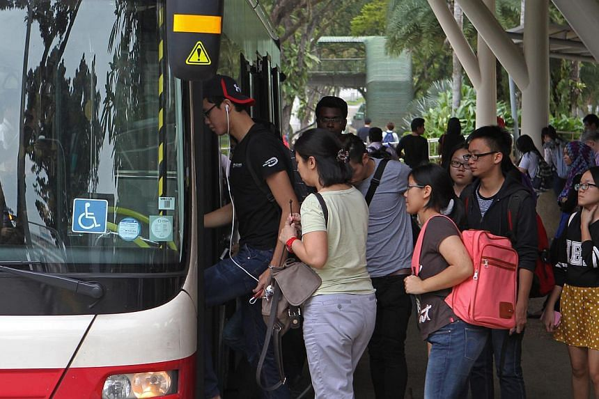 The Public Transport Council announced a fare hike on Thursday, Jan 16, 2014, along with new concessions for students, disabled individuals and low-wage workers. A new monthly pass for heavy transport users was also announced. -- ST PHOTO:SEAH