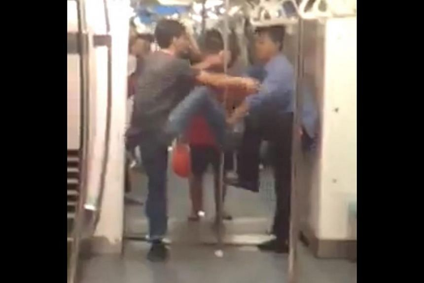 A video of two men fighting on an SMRT train last week has gone viral online. -- PHOTO: SCREENGRAB FROM VIDEO