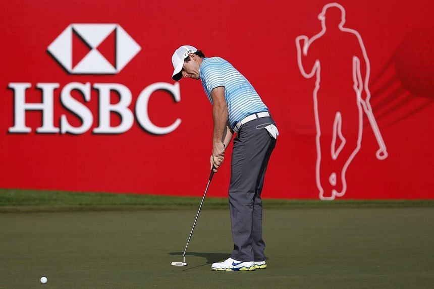 Rory McIlroy of Northern Ireland hits the ball on the 18th green during the Abu Dhabi Golf championship on Jan 16, 2014.Henrik Stenson's magical touch deserted him on the first day back in office in the new year, but world number seven McIlroy