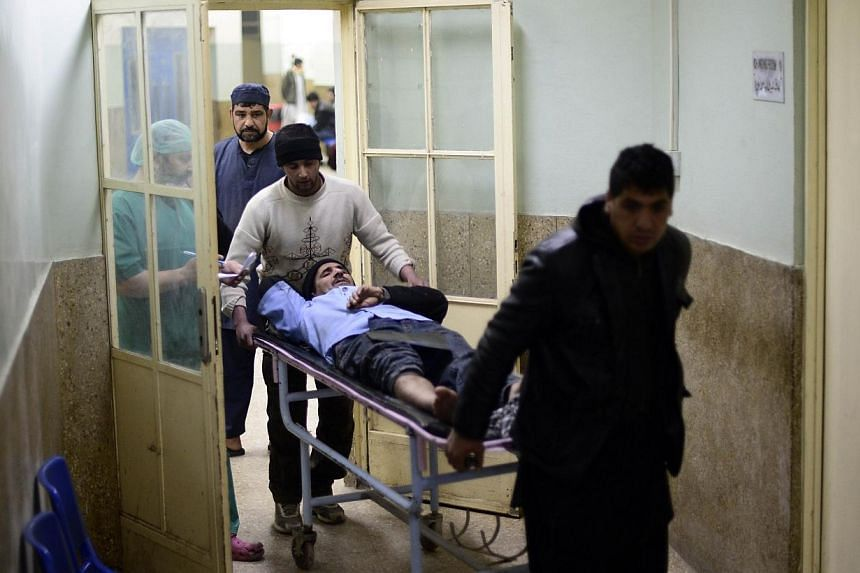 Kebab cook Abdul Majid is stretchered in the Wazir Akbar Khan hospital in Kabul on Jan 17, 2014.The wittness of the suicide attack had received fractures as he escaped the scene. -- PHOTO: AFP