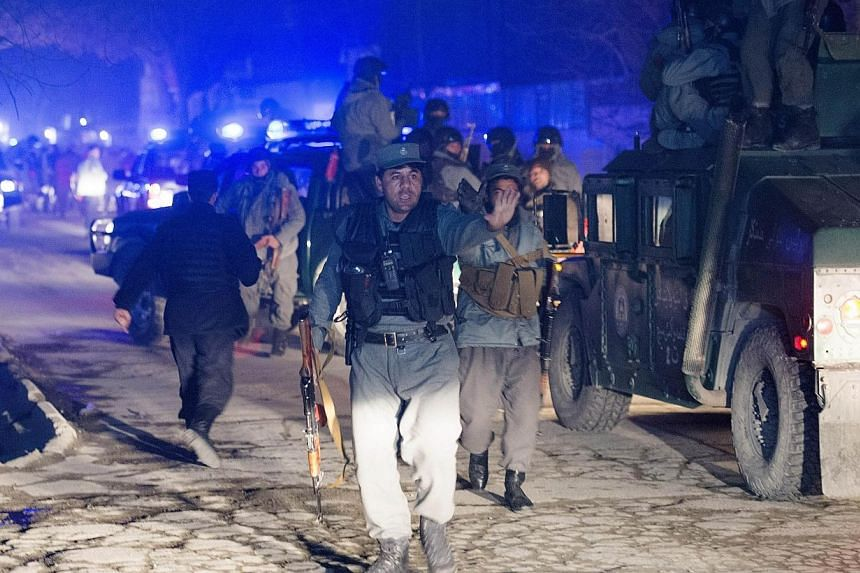 Afghan police arrive at the scene of an explosion in Kabul, on Jan 17, 2014. -- PHOTO: AFP