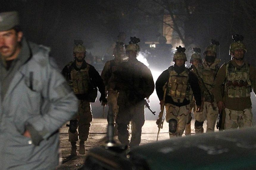 Afghan security forces arrive at the scene of an explosion in Kabul, on Jan 17, 2014. -- PHOTO: REUTERS