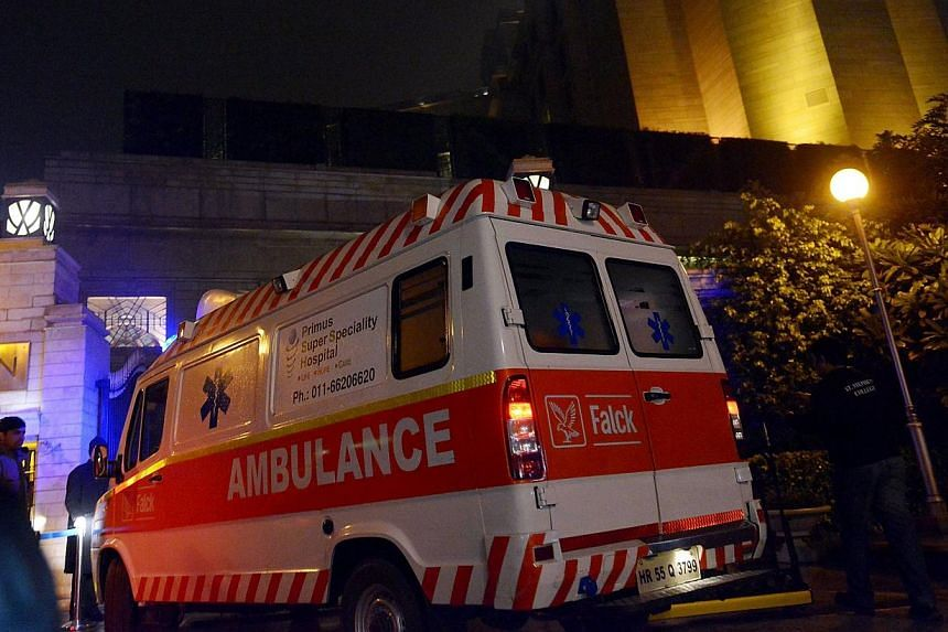 An ambulance arrives at the Leela Hotel in New Delhi on Jan 17, 2014 where wife of Indian Minister Shashi Tharoor, Sunanda Pushkar was found dead. -- PHOTO: AFP