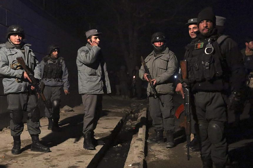 Afghan police arrive at the scene of an explosion in Kabul. -- PHOTO: REUTERS
