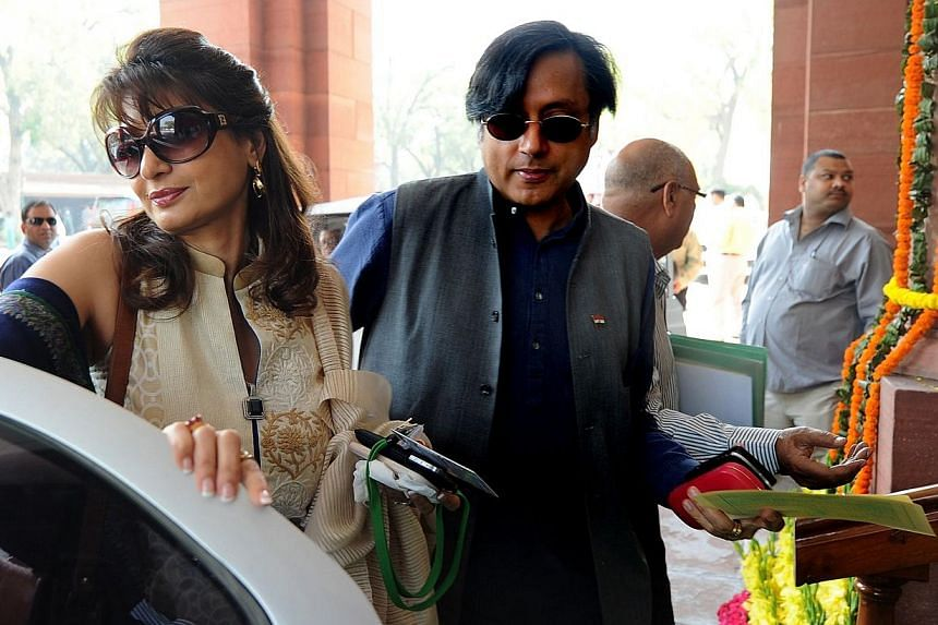Minister Shashi Tharoor with his wife Sunanda Pushkar arrive at parliament for the opening of the budget session in New Delhi in 2012. -- PHOTO: AFP