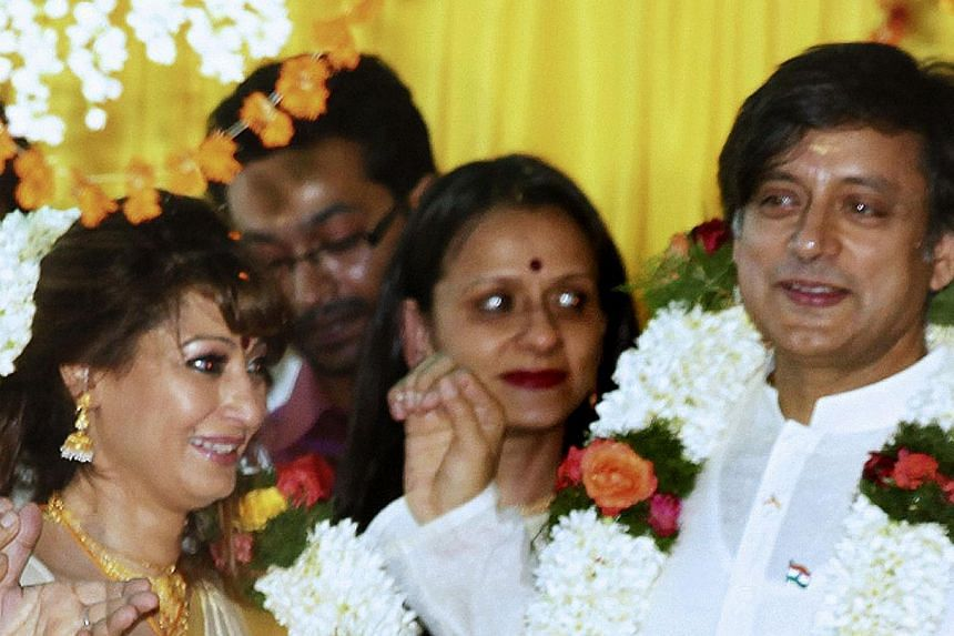 File photo of Indian parliamentarian Shashi Tharoor (right) and his bride Sunanda Pushkar (left) taken in their wedding ceremony in Pallakad in 2010. -- PHOTO: AFP