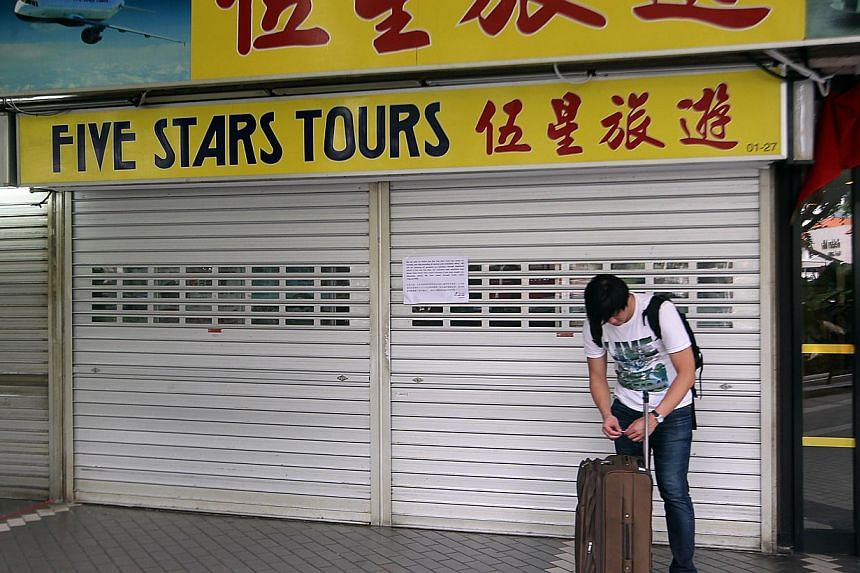 Workers who lost their jobs because of the sudden closure of Five Stars Tours travel agency can get help, including immediate financial assistance, if they are union members. -- ST FILE PHOTO:LAU FOOK KONG