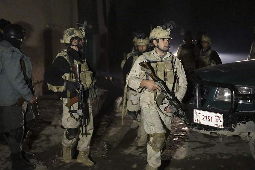 Afghan security forces arrive at the scene of an explosion in Kabul on Jan 17, 2014. United Nations leader Ban Ki Moon on Friday strongly condemned a suicide gun and bomb attack on a Kabul restaurant in which three UN staff were among at least 14 fat
