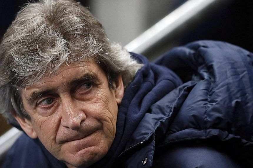 Manchester City's manager Manuel Pellegrini reacts ahead of their FA Cup third round soccer match against Blackburn Rovers at the Etihad stadium in Manchester, north-west England, on Jan 15, 2014. Pellegrini has warned his Manchester City stars not t