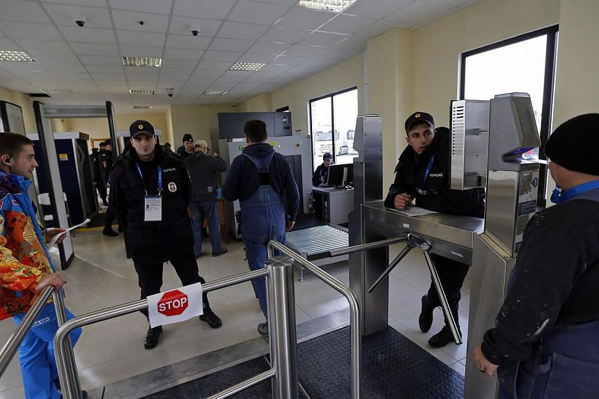 Security guards check visitors at the entrance to the olympic park in Adler near Sochi on Jan 16, 2014.Russian President Vladimir Putin has vowed to ensure full security at next month's Winter Olympics in Sochi despite fears of a resumption of