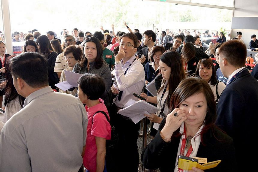 There were plenty of younger people among the 1,000 hopeful buyers thronging The Hillford's showflat yesterday. The project's 60-year lease allowed the developer to price units more cheaply. -- ST PHOTOS: LIM SIN THAI