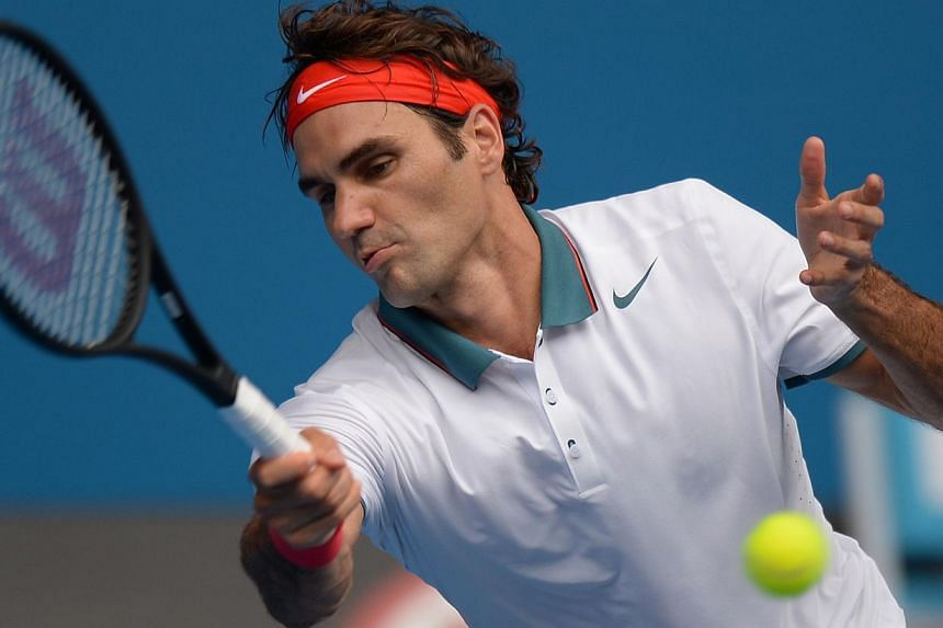 Switzerland's Roger Federer plays a shot during his men's singles match against Russia's Teymuraz Gabashvili on day six of the 2014 Australian Open tennis tournament in Melbourne, on Jan 18, 2014. -- PHOTO: AFP