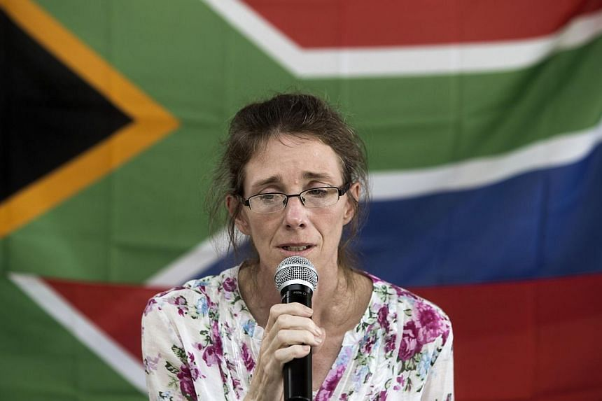 South African Yolande Korkie, a former hostage and wife of Pierre Korkie, holds a press conference in Johannesburg on January 16, 2014 to appeal for the release of her husband, still held in Yemen. -- PHOTO: AFP