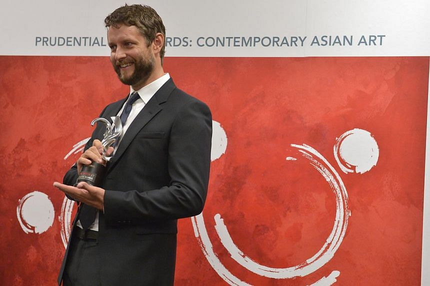 Australian artist Ben Quilty was all smiles, after being declared the overall winner of the inaugural Prudential Eye Awards on Saturday night.-- ST PHOTO: KUA CHEE SIONG
