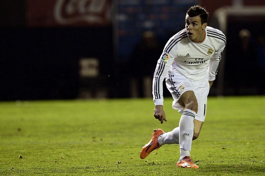 Real Madrid's Gareth Bale reacts during their Spanish King's Cup soccer match against Osasuna at Reyno de Navarra stadium in Pamplona on Jan 15, 2014. Bale can do better, Real Madrid coach Carlo Ancelotti said on Jan 17. -- FILE PHOTO: REUTERS